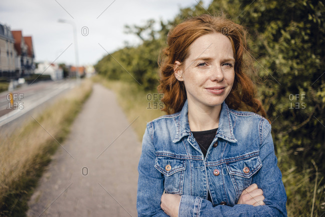 Redheaded woman with arms crossed- portrait