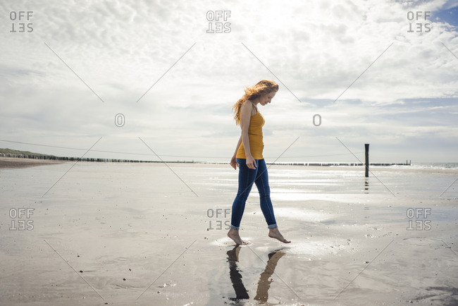 Woman relaxing at the beach- strolling around