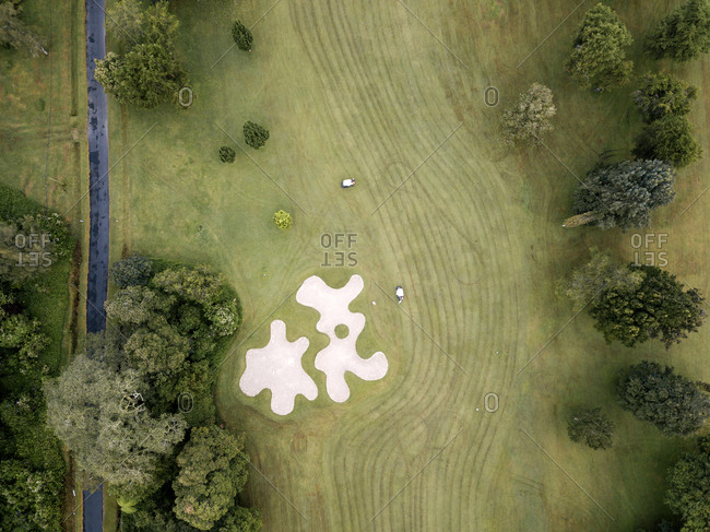 Indonesia- Bali- Aerial view of golf course with bunker and green