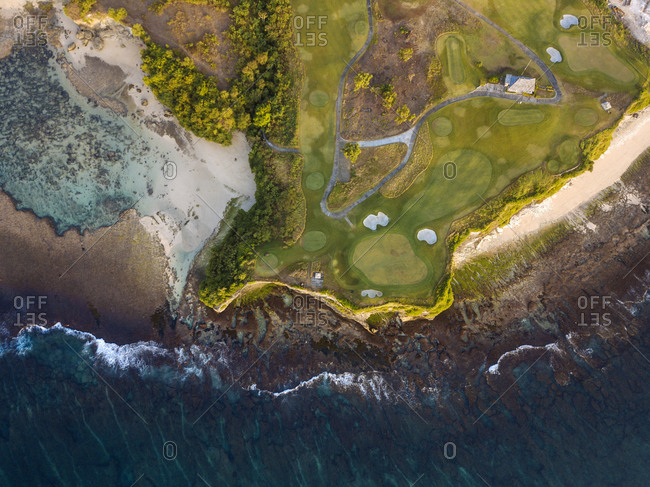 Indonesia- Bali- Aerial view of golf course with bunker and green at coast