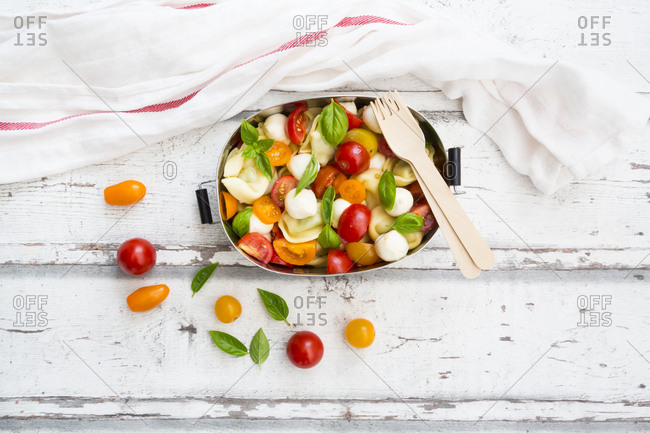Tortellini salad with tomato- mozzarella and basil in lunch box