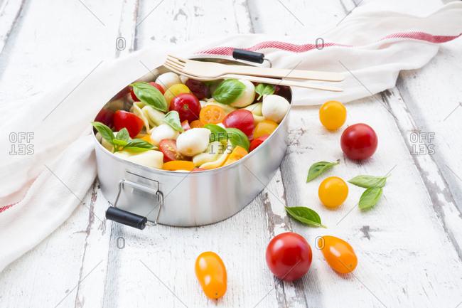 Tortellini salad with tomato- mozzarella and basil in lunch box