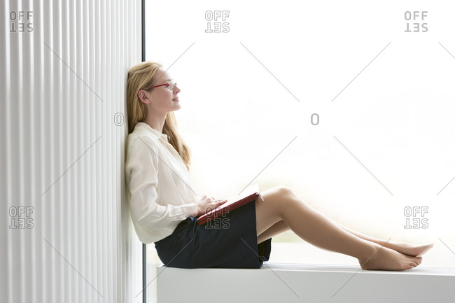 Poland- Warzawa- businesswoman having a break