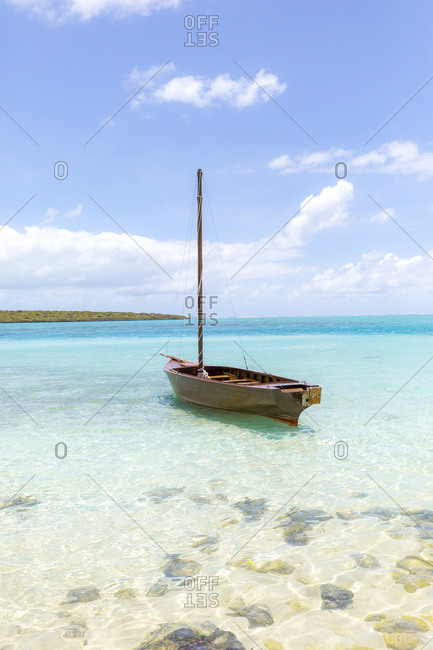 Mauritius- Grand Port District- Pointe d'Esny- sailing boat in turquoise water- blue sky and clouds