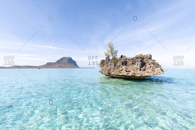Mauritiusm Riviere Noire District- La Gaulette- small rock- crystal rock in turquoise water