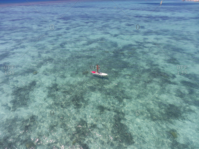 Mauritius- young woman on stand up paddling board