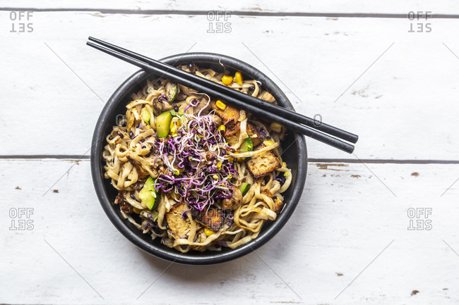 Mie noodles with tofu- zucchini- maize and red sprouts
