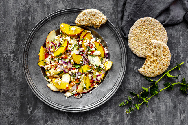 Salad with peaches- feta and mint served with pita bread