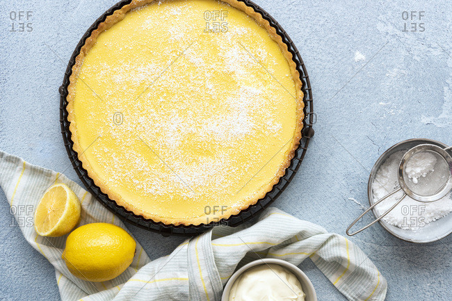Homemade lemon tart dusted with icing sugar.