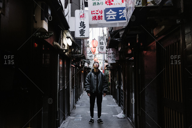 Tokyo, Japan - February 9, 2018: Man in Japanese alleyway