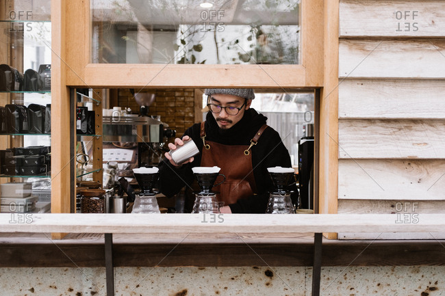 Tokyo, Japan - February 10, 2018: Barista making coffee