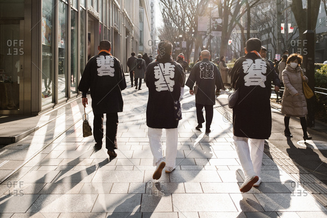 Tokyo, Japan - February 11, 2018: Japanese men walking