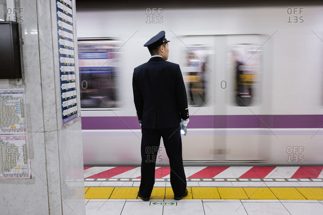 Tokyo, Japan - February 11, 2018: Train conductor in Tokyo