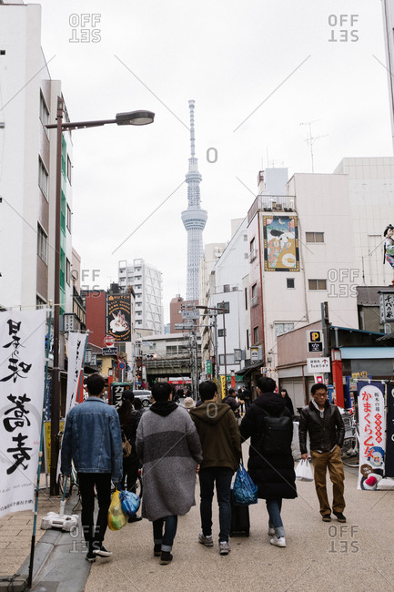 Tokyo, Japan - February 11, 2018: Tourists walking in Japanese streets