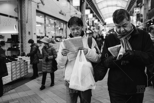 Tokyo, Japan - February 11, 2018: Men walking in Tokyo