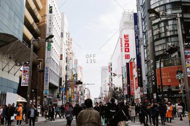 Tokyo, Japan - February 11, 2018: People walking in Tokyo streets