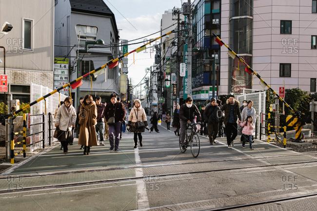 Tokyo, Japan - February 13, 2018: People crossing road in Tokyo