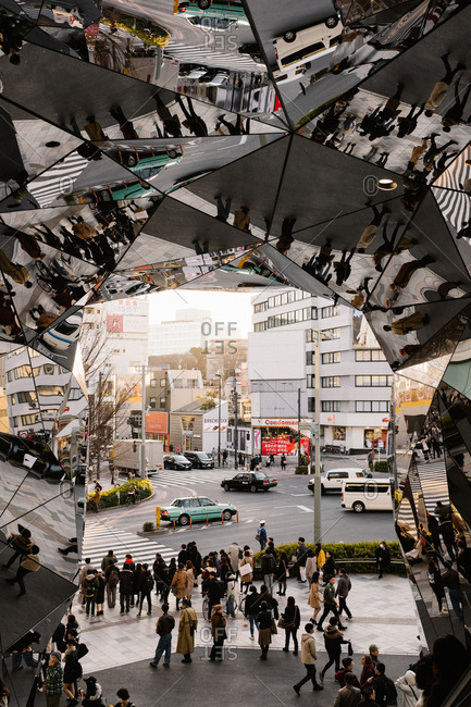 Tokyo, Japan - February 14, 2018: Mirrored entryway to building in Tokyo