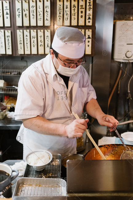 Tokyo, Japan - February 14, 2018: Japanese chef cooking tempura
