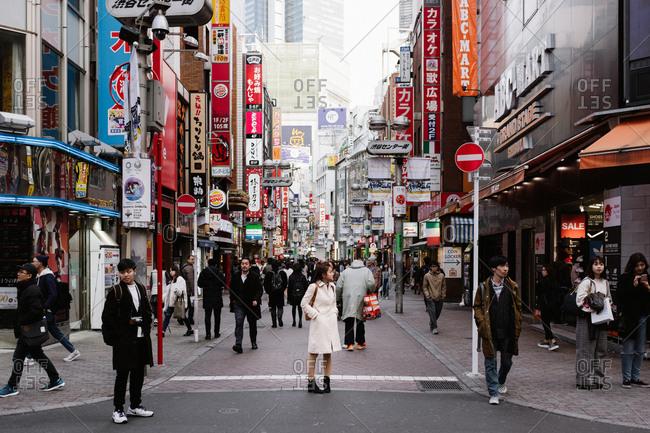 Tokyo, Japan - February 15, 2018: People walking through streets in Tokyo