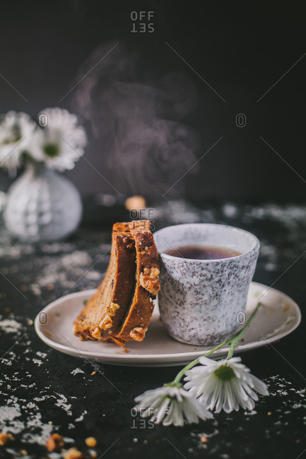 Slices of freshly baked bread served with a cup of steaming hot coffee