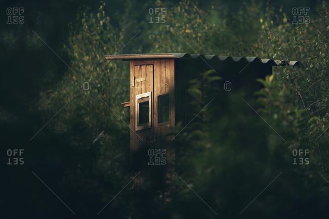 Wooden deer blind in the woods