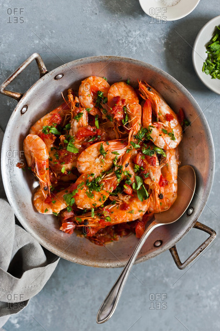 Orange shrimp and parsley in a pan