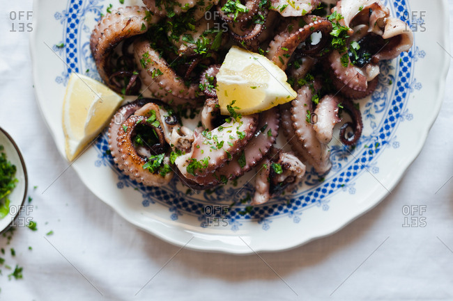 Overhead view of squid dish with lemon