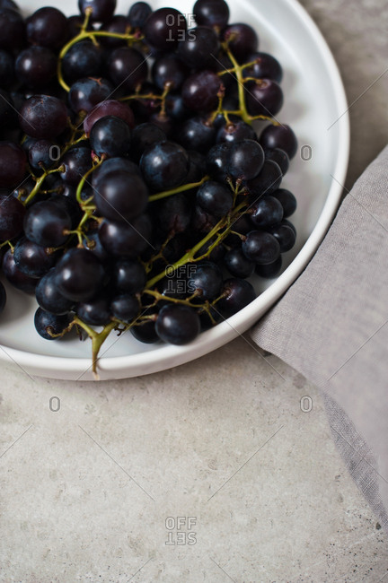 Black grapes on a plate