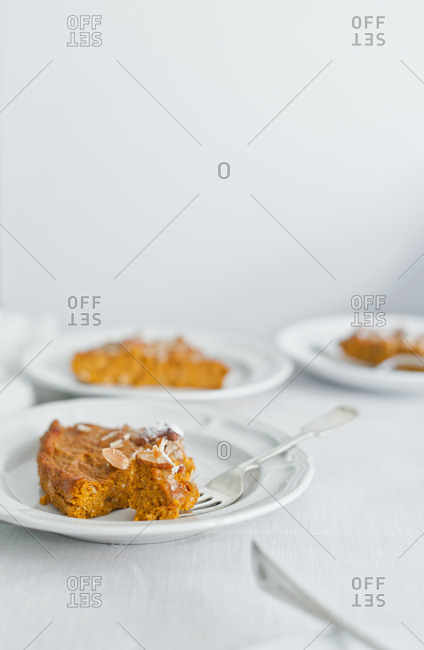 Piece of pumpkin pie with almonds