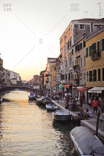 Boats on a canal at sunset in Venice, Italy