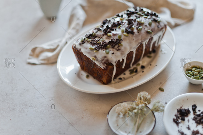 Pumpkin olive chocolate cake topped with nuts
