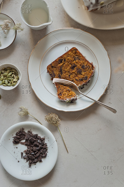 Top view of a  slice of pumpkin olive chocolate cake