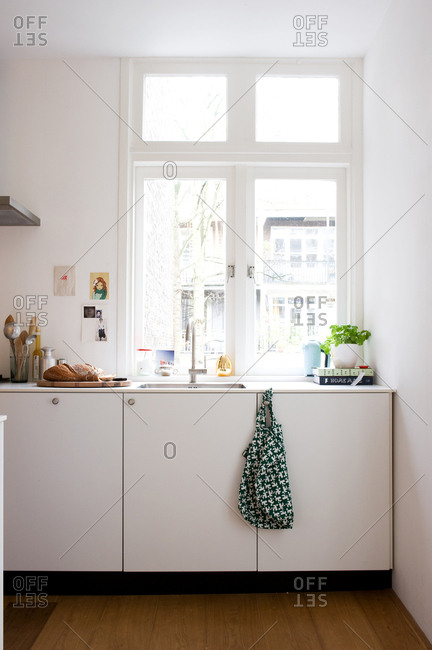November 25, 2010: Simple white modern kitchen in an apartment
