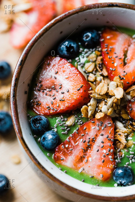 Smoothie bowl with fruit, granola, and chia seeds