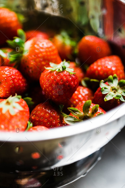 Close up of fresh red strawberries in a colander