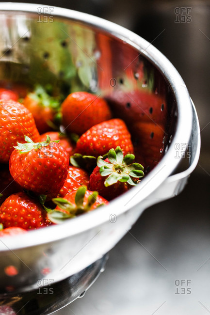 Red strawberries in a colander