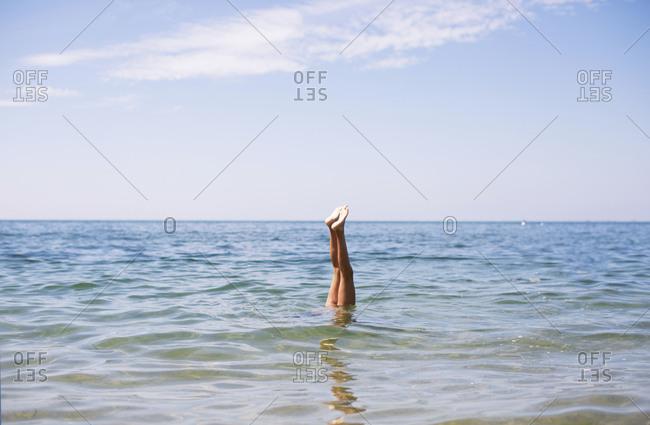 Girl doing handstand in water
