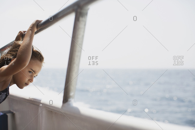 Young girl on ferry looking out at the ocean