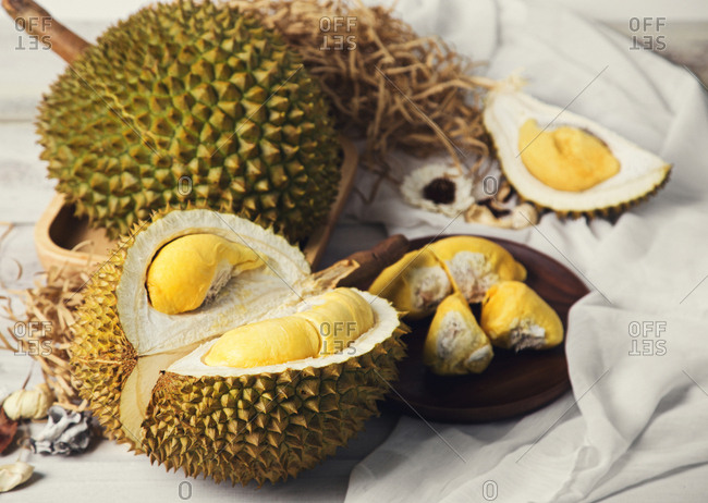 Open durian and fruit served on plate
