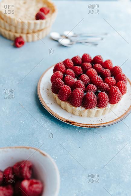 Raspberry tart on a blue background