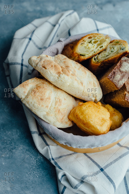 Different kinds of bread on blue background