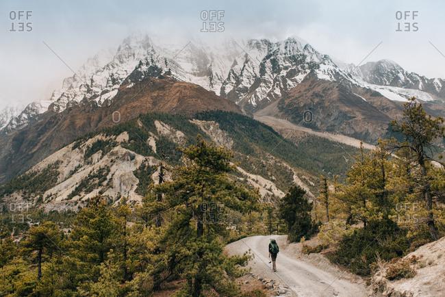 Hiker on trail, Annapurna Circuit, the Himalayas, Manang, Nepal