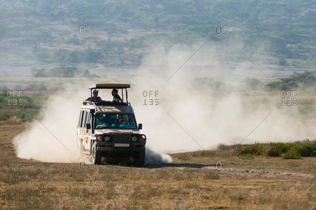 SerengetiFebruary 26, 2018: A safari vehicle driving in the Ndutu area, Ndutu, Ngorongoro Conservation Area, Serengeti, Tanzania
