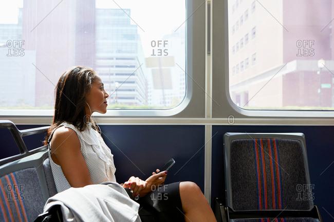 Businesswoman on train