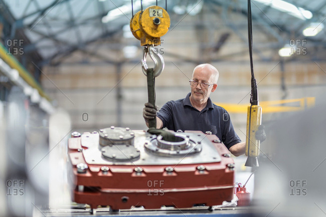 Engineer assembling gearbox in gearbox factory