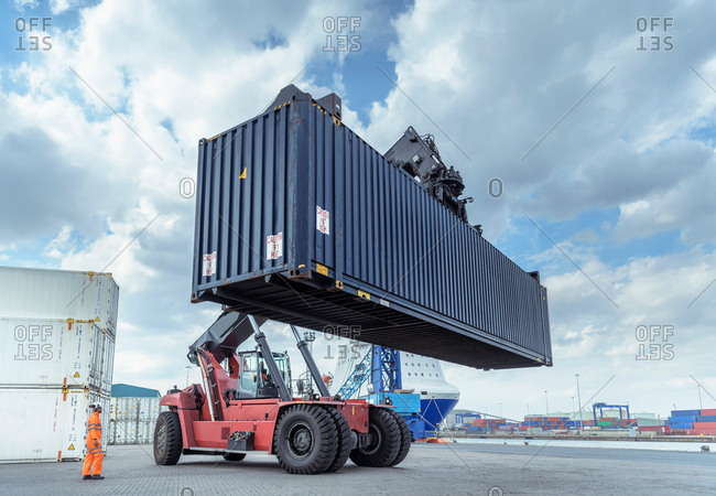 July 23, 2018: Container lift with shipping container in port