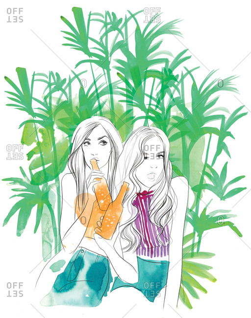 Two young women holding bottles and sitting together under palm trees