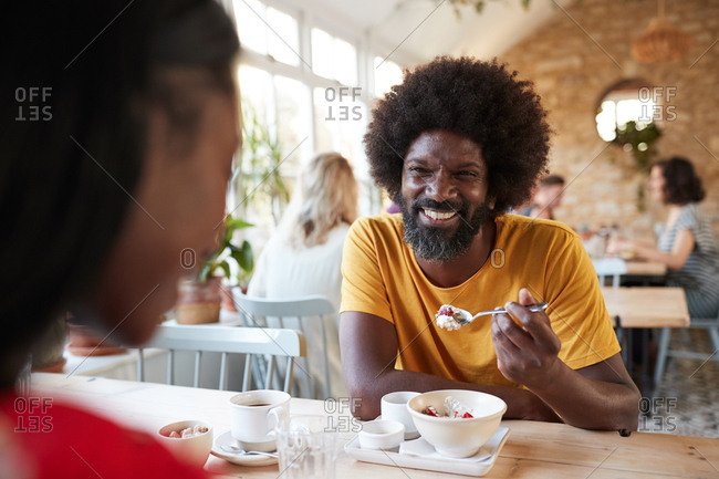 Black couple having breakfast at cafe, close up