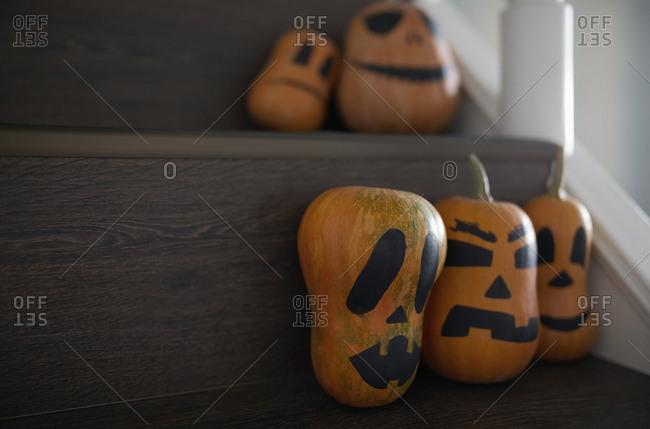 Halloween pumpkins on a wooden stairs